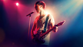 singer guitar 350x197 - Watch Louis Tomlinson Stage Desert Concert in 'Walls' Video